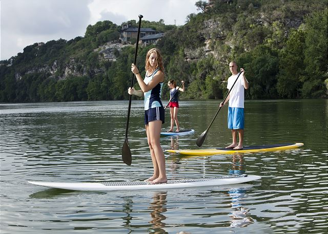 Enjoy some Stand Up Paddle Boarding on Lake Austin. ARRIVE will set it up for you!