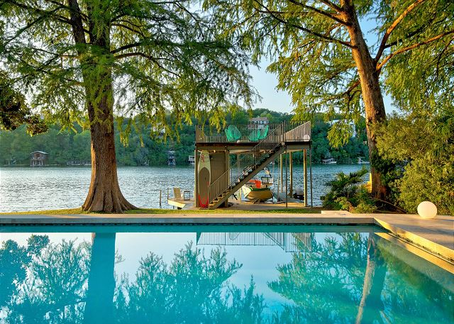 Gorgeous summer days are meant to be spent in this pool and on the upper level dock soaking in the sun
