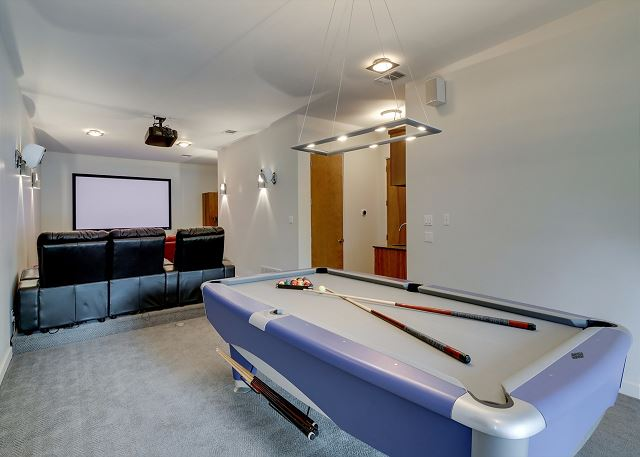 Play a game of pool and enjoy a movie with family and friends