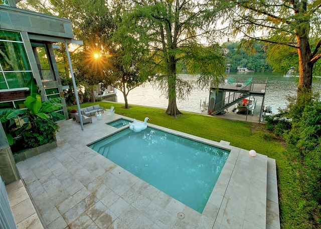 Spacious outdoor area with large pool, hot tub, and lawn space perfect for family reunions