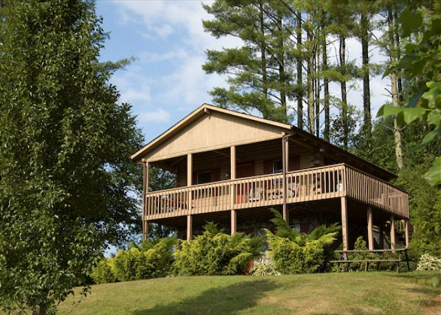 Enjoy this modern day log cabin with oversized covered porch.