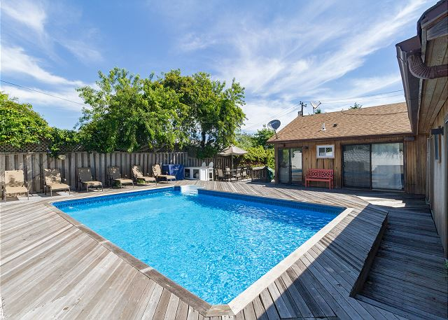 Jump into your beautiful vacation pool on your private deck at this Fire Island home!