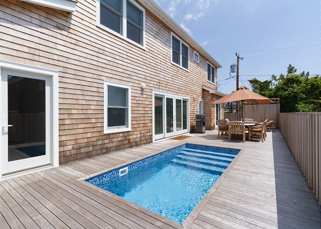 Enjoy the outdoors with your private pool, spacious deck, and outdoor shower at this incredible bungalow home!