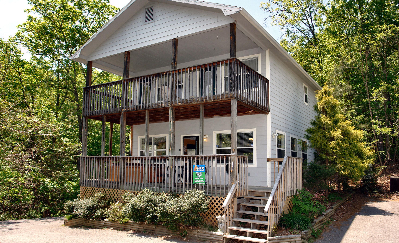forge life downtown luxury of pigeon bedroom gatlinburg cabin rental cabins