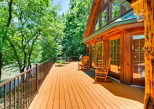 A River Adventure #4237 4BR Pigeon Forge River Lodge has 2 hot tubs, 2 fireplaces, & fishing access!