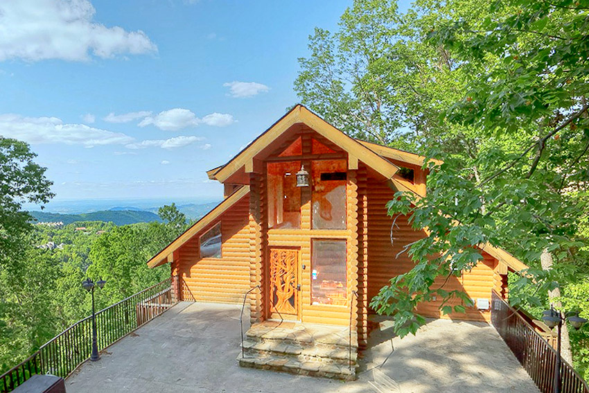 Gatlinburg cabin rental emerald city lights bedroom