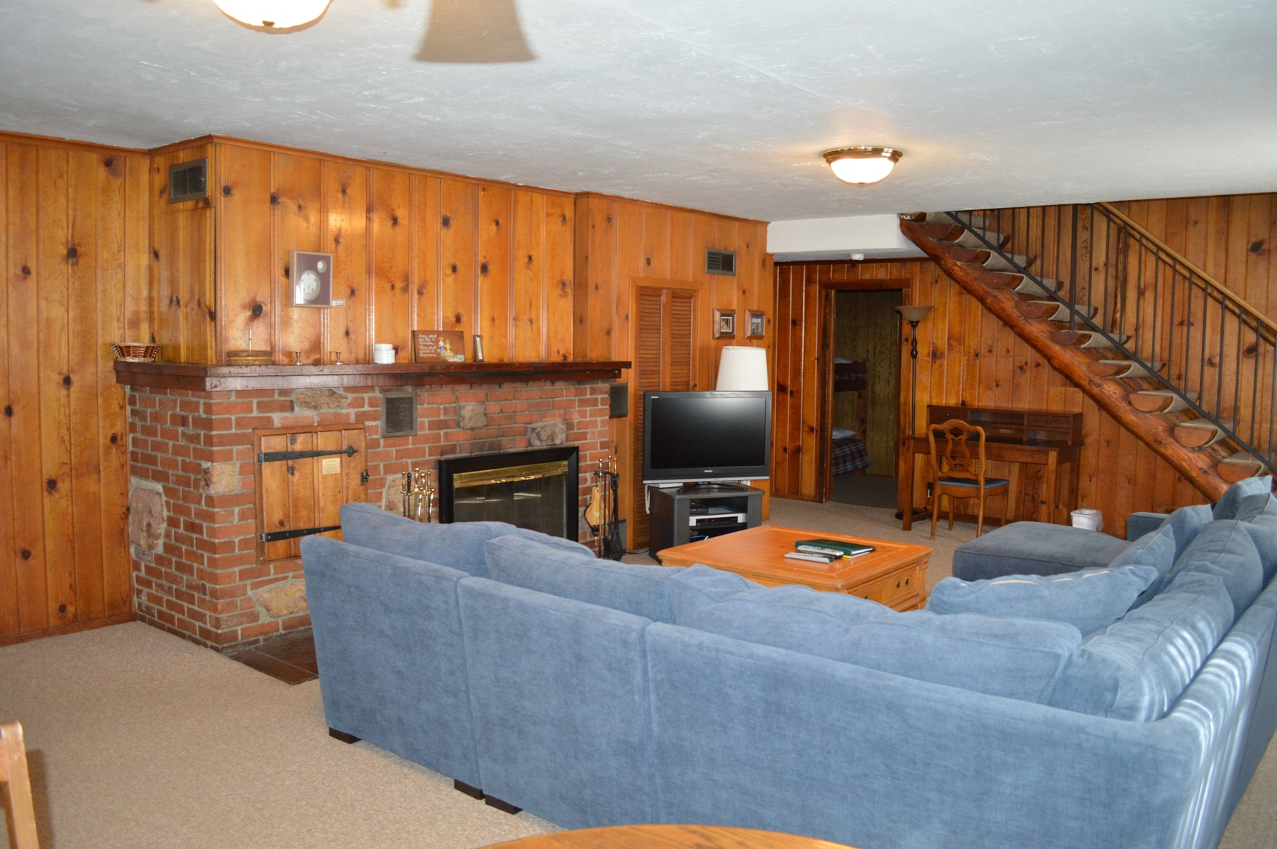 Spacious living room with big L shape sofa for a big family gath