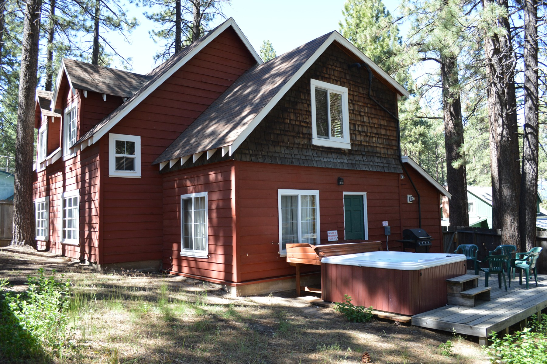 Birch Cabin exterior picture with a hot tub and patio furniture