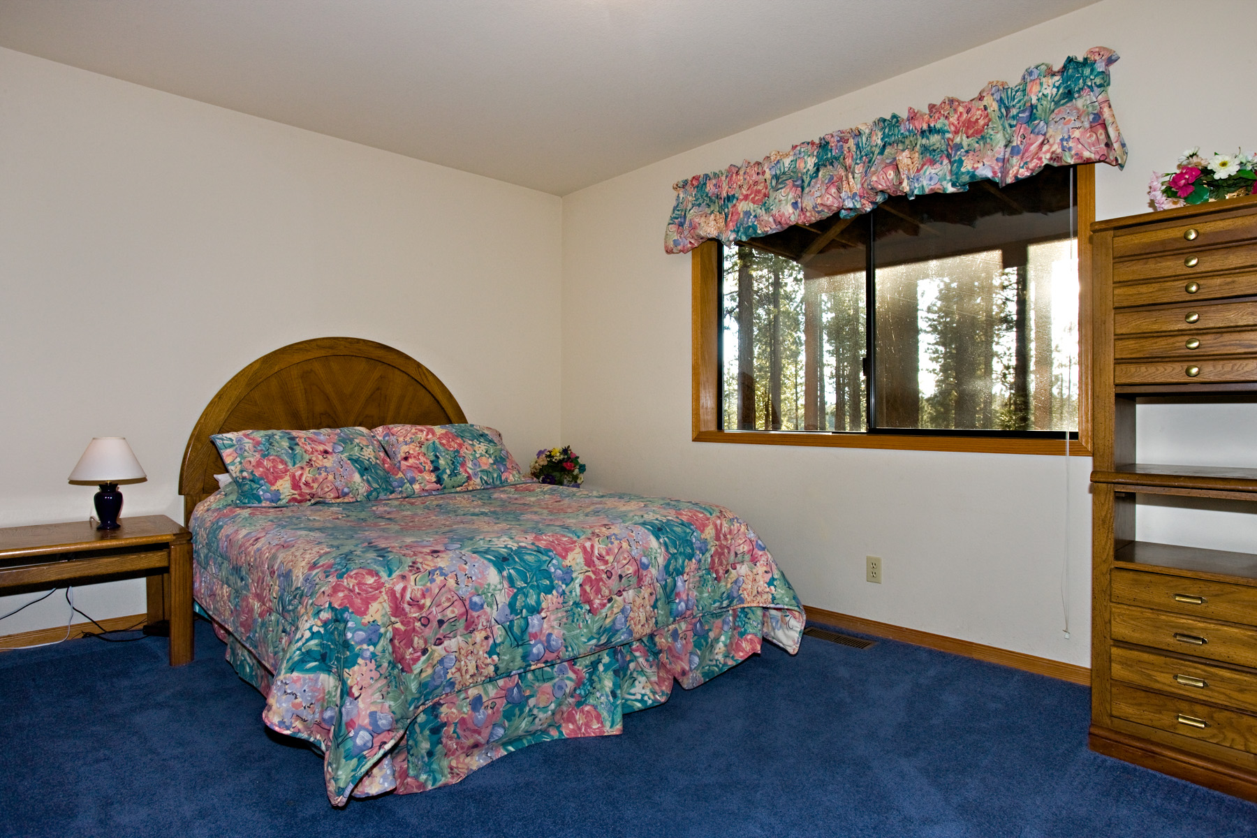 The third bedroom has a queen bed and a view