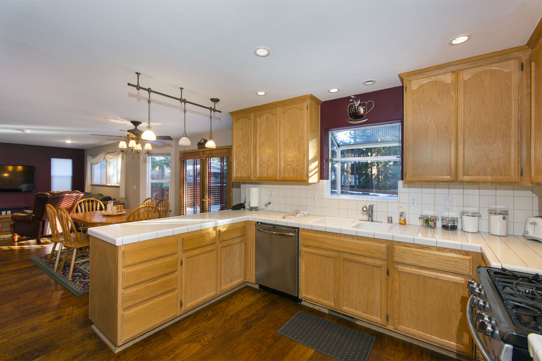 The comfortable kitchen opens up to the breakfast room which ope