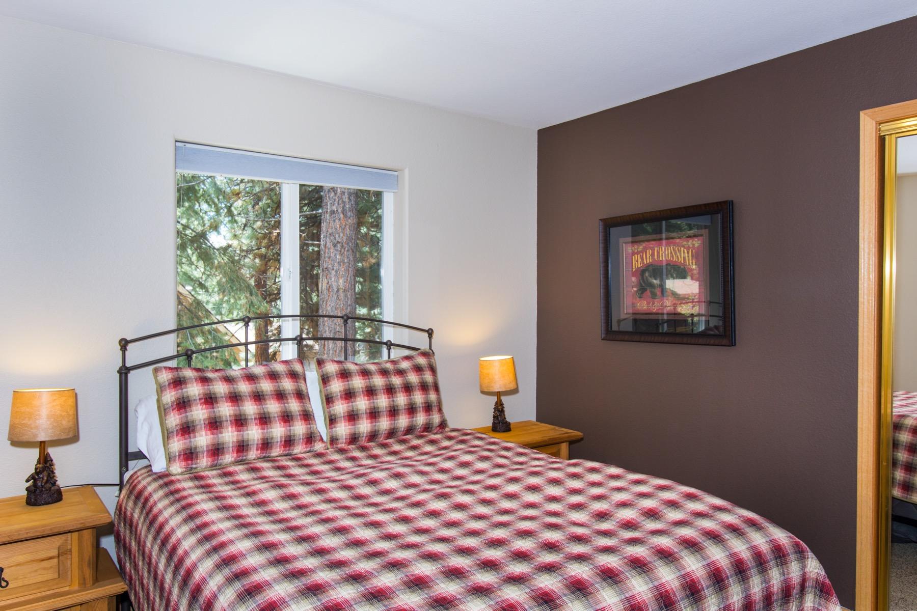 The queen bed in the third bedroom