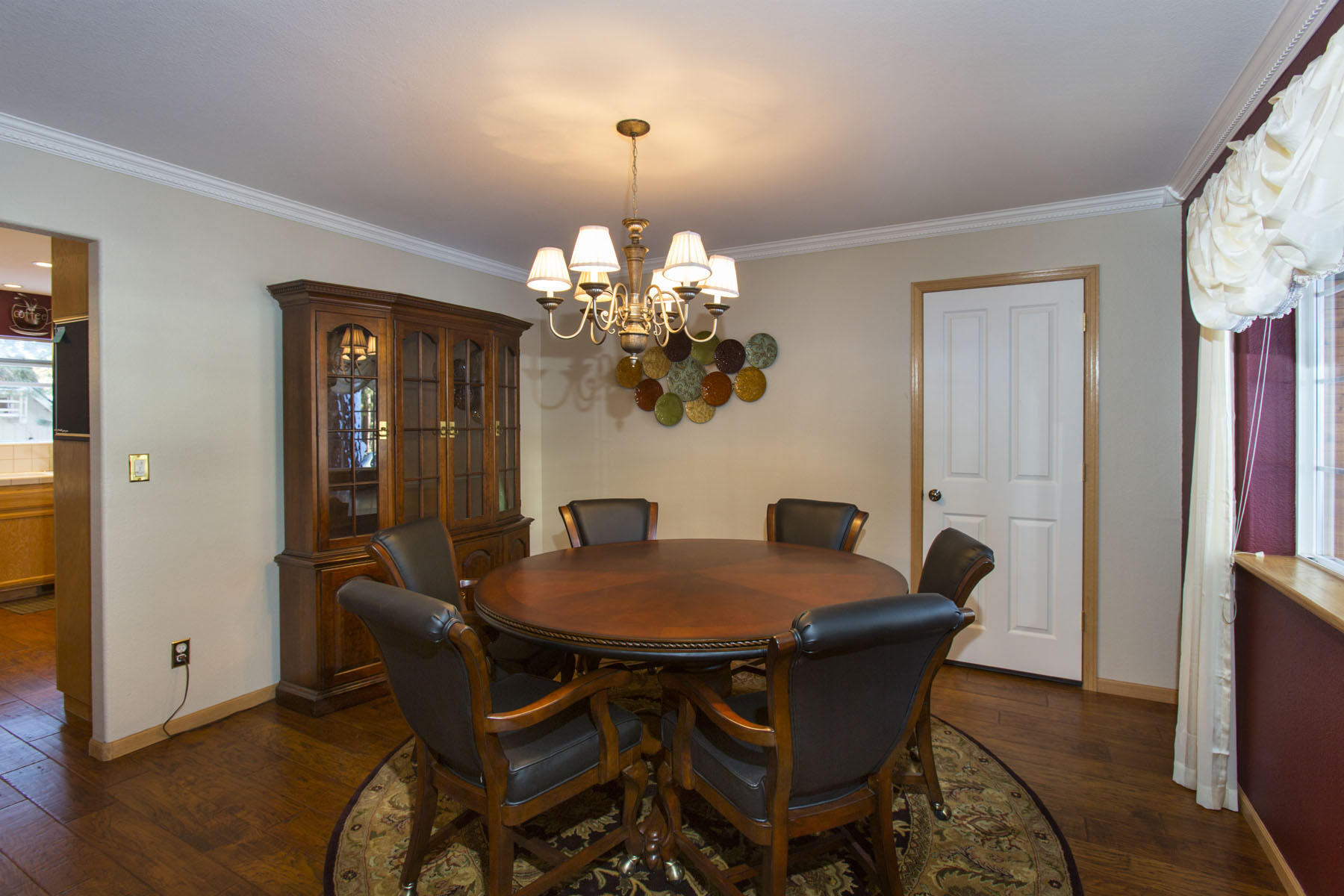 The beautiful circular dining table doubles as a game table.Just