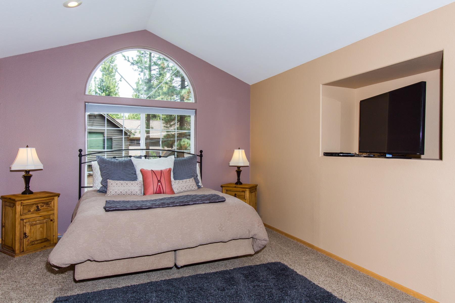 Appreciate  this spacious master bedroom with big windows.