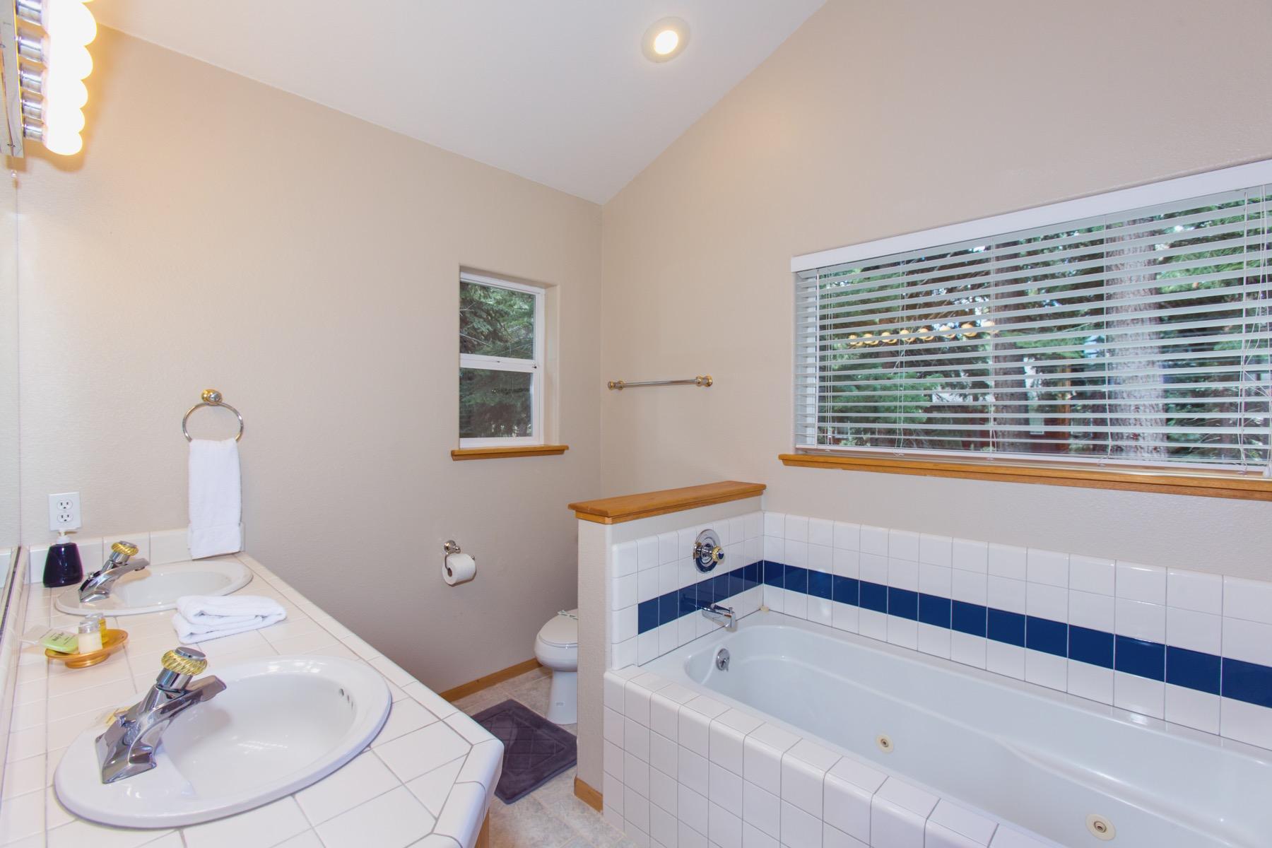 Take a bath in this bright bathroom.