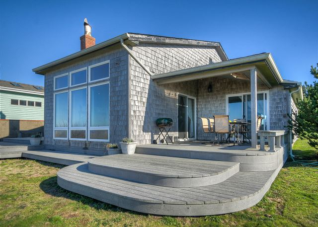Covered patio with seating for 4-6 guests allows you to enjoy the ocean front in any weather.