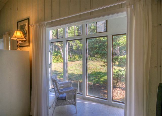 In the Master Bedroom is a quiet sitting area that looks into the wooded back yard. Great for relaxing with a cup of coffee or tea.