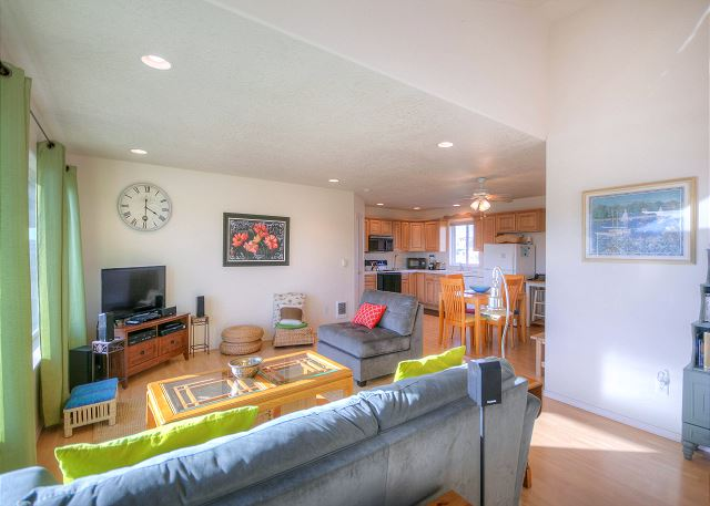 Sunny and warm livingroom with surround sound speakers for movie watching. Windows open for a view of the Alsea Bay Bridge