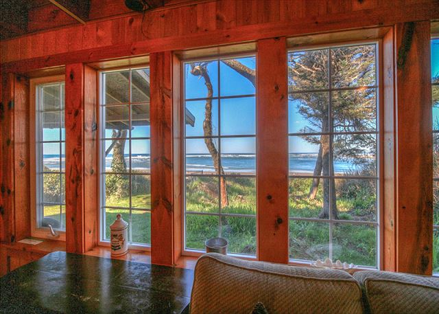 View from the livingroom Side B on the main level. Window look out over the back yard and towards the ocean front.