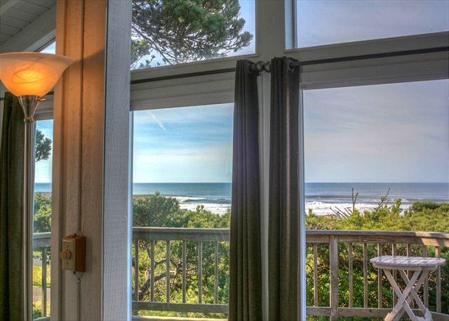 View from the living room through ceiling to floor windows to ocean