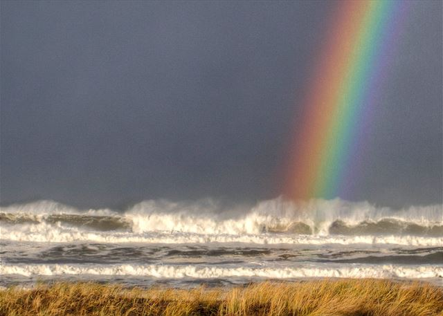 This isn't a doctored picture. The rainbow is on the ocean side just a 3 block walk down the street.