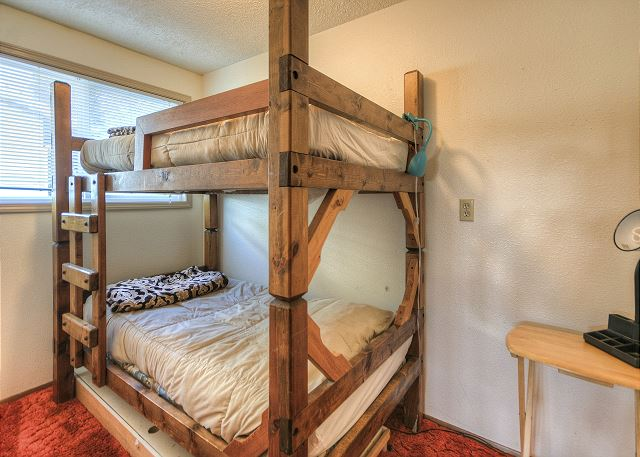 Twin bunks are located in room off the garage. Bathroom is easy to access right inside door to house.