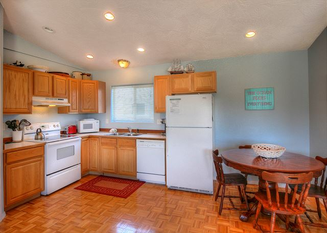 Kitchen with all the amenities. Microwave, dishwasher. Seating for 4