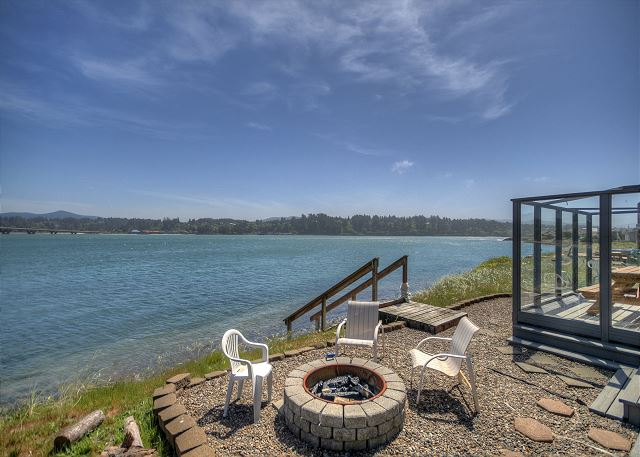 Sit around the fire pit in the morning and enjoy a cup of coffee by the bay.