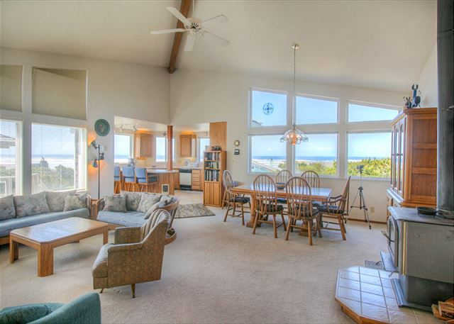 Livingroom with views toward the ocean. Dining seating for 6, breakfast bar sits 3