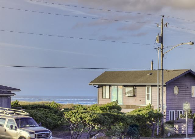 View from the front deck of house. Access to the beach directly across the street.