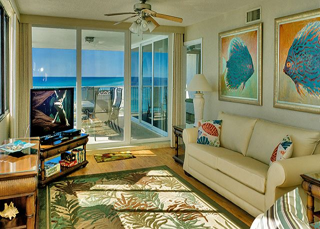 LARGE LIVING AREA WITH BIG SCREEN TV AND VIEWS GALORE