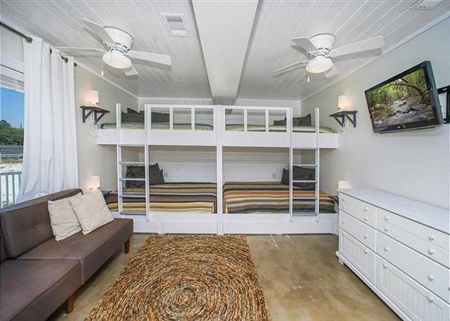 Ground floor bunk room (four queens beds).