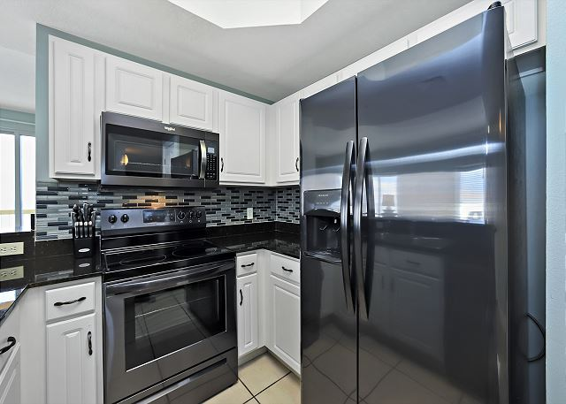 CALYPSO 301 KITCHEN WITH STAINLESS APPLIANCES