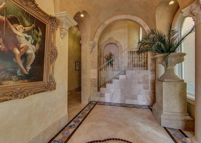 DRAMATIC ENTRANCE FOYER WITH BEAUTIFUL WORKS OF ART
