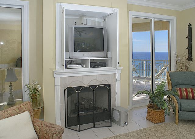 BIG SCREEN TV OVER THE FIREPLACE
