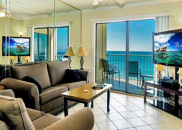 COMFORTABLE LIVING AREA WITH GREAT BALCONY VIEWS