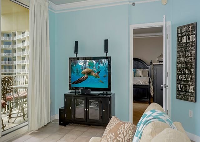 BIG SCREEN TV WITH SURROUND SOUNT TO ENJOY