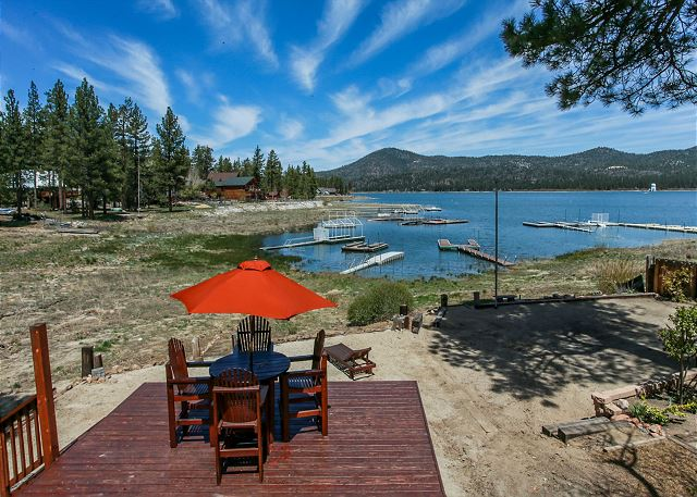 Seating area on back deck with a beautiful view of the Lake