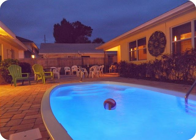 A private pool, gazebo, 22 ft by 22 ft space completely enclosed and between the two buildings.