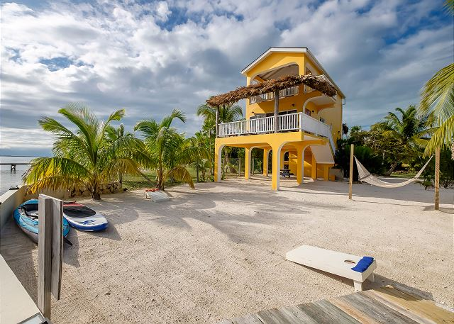 The perfect beach house! Ocean side with your own private beach, paddle board, kayak and bikes!