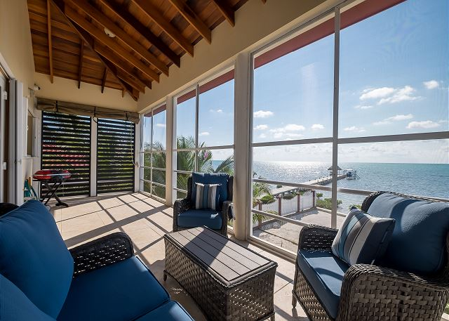 Covered veranda allows sunlight in during the morning and shade in the afternoon but there's never an obstructed view of the turquoise waters!