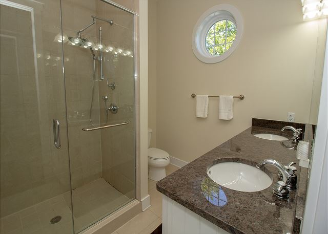 King Master attached bath with double vanity and walk in shower.