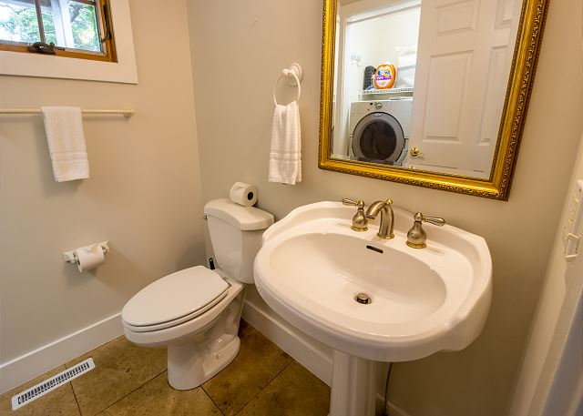 Main Level powder room with washer and dryer
