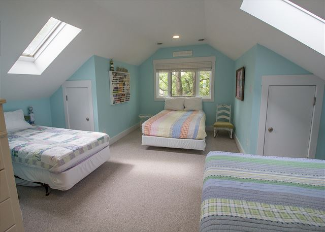 Upstairs bedroom with two full beds and one twin
