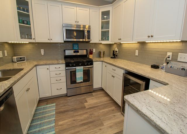 Main level fully loaded Kitchen with wine fridge