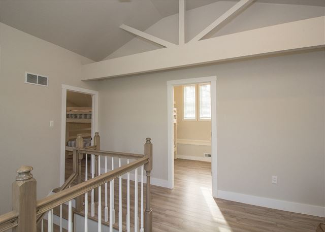 Stairway leads to the open loft and 3 additional bedrooms on the