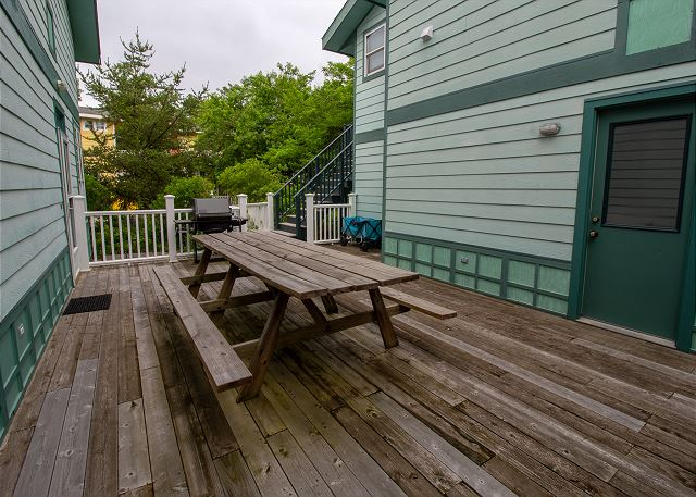 Porch on side of home with picnic table