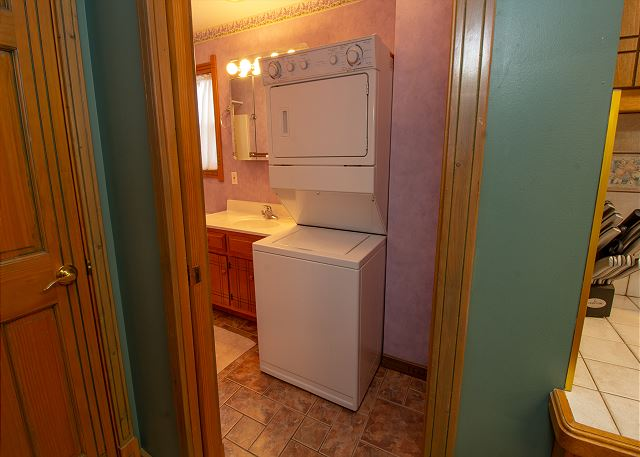 Washer and dryer next to the bathroom