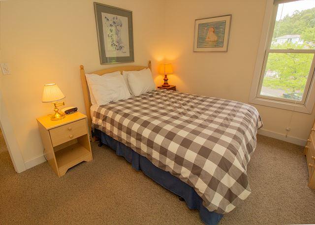 Second level bedroom 3 queen bed with door to screened in porch