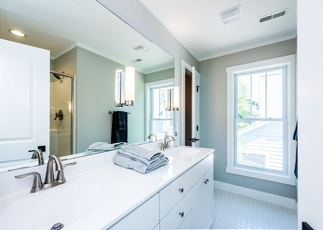 King suite bath with double sink and walk in shower.