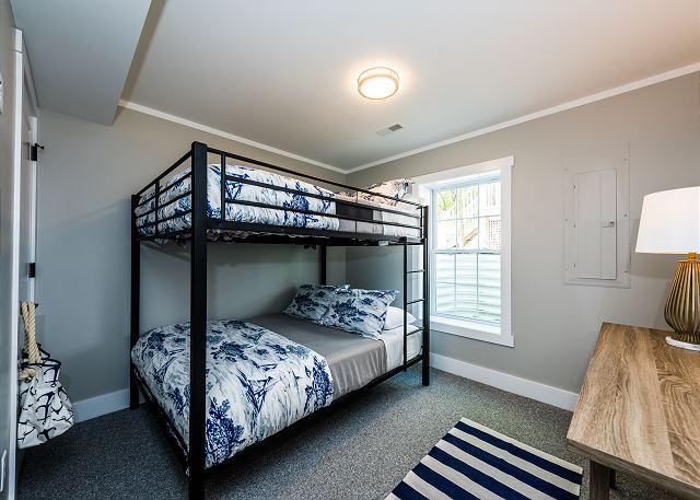 Basement level Queen over queen bunk room